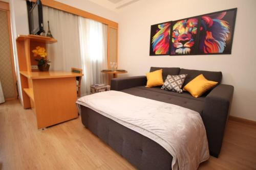 A bed or beds in a room at Flat 4 Estrelas Jardins