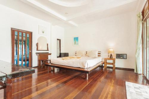 Ein Bett oder Betten in einem Zimmer der Unterkunft Resolution Resort