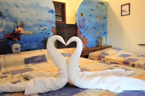 Een bed of bedden in een kamer bij Ecological Hotel Maya Luna