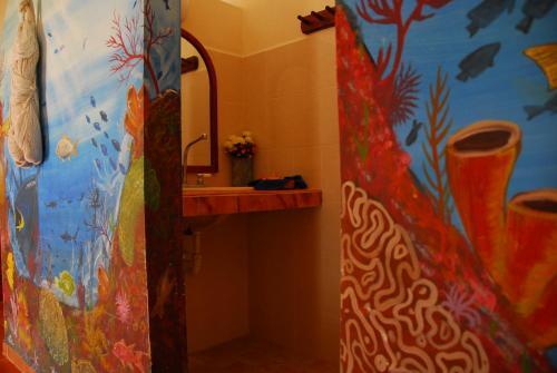 Een badkamer bij Ecological Hotel Maya Luna
