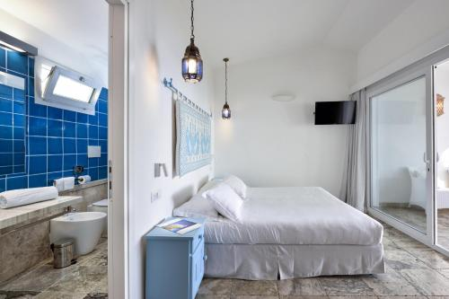 A bed or beds in a room at Arbatax Park Resort - Telis