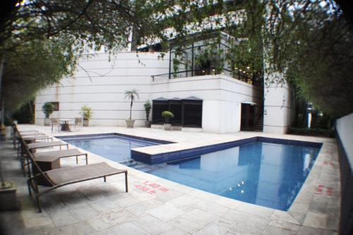 The swimming pool at or close to Flat 4 Estrelas Jardins