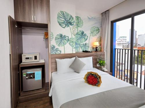 A bed or beds in a room at Mega Light Hotel - Managed By RHM GROUP