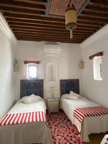 A bed or beds in a room at Casa Perleta