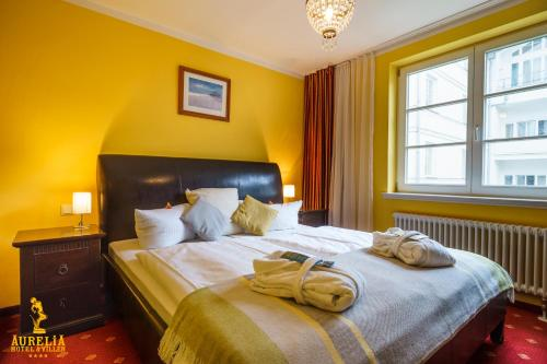 A bed or beds in a room at Aurelia Hotel St.Hubertus