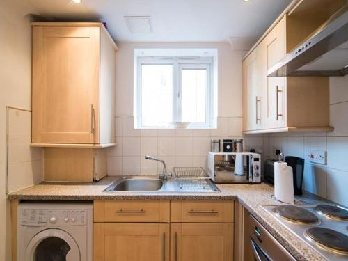 A kitchen or kitchenette at My-Places South Manchester Apartment 5