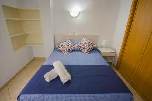 A bed or beds in a room at Hostal Guillot