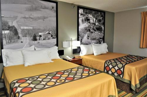 A bed or beds in a room at Super 8 by Wyndham Clearfield