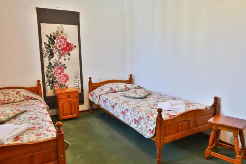 A bed or beds in a room at Guest Houses Kedar