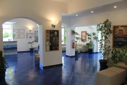 The lobby or reception area at Hotel Residence La Darsena