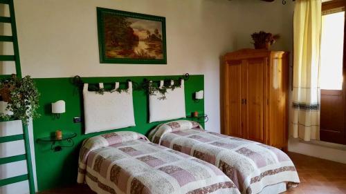 Letto o letti in una camera di Antica Casa Pasolini