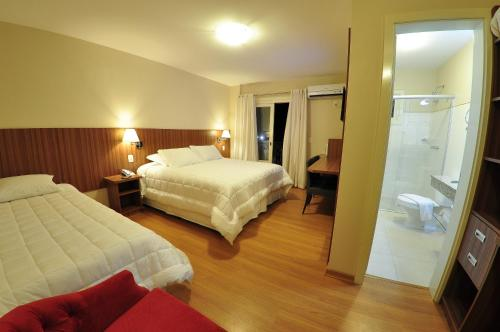 A bed or beds in a room at Rothenburg Hotel