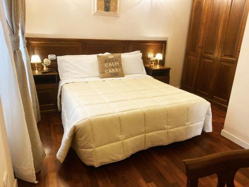Letto o letti in una camera di Relais Cavour