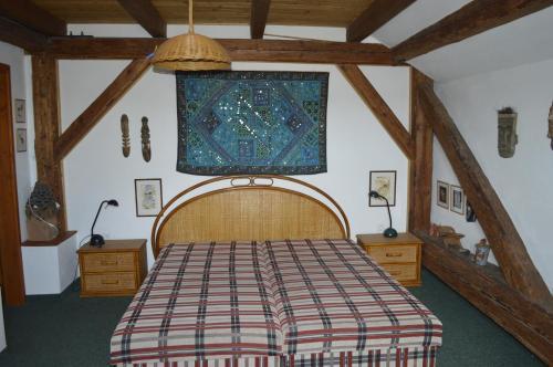 Postel nebo postele na pokoji v ubytování Penzion Medvedi Paseka