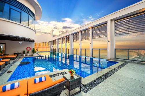 The swimming pool at or near Altara Suites by Ri-Yaz