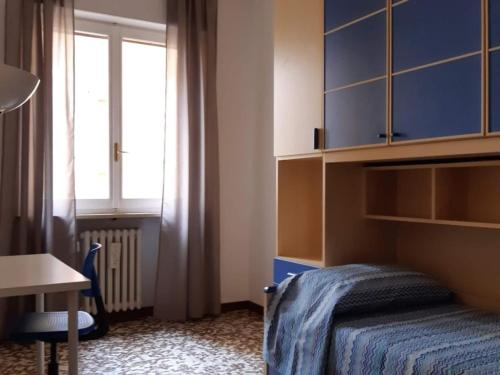 A bed or beds in a room at Appartamento Soleluna