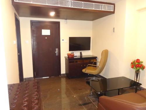A television and/or entertainment center at Pride Ananya Resorts