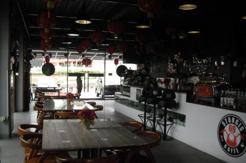 The lounge or bar area at Sturgis Boutique Hotel Cipanas
