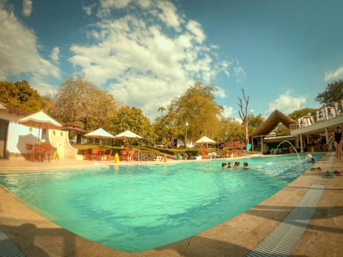 The swimming pool at or near Hotel la Ardilla de Santa Fe