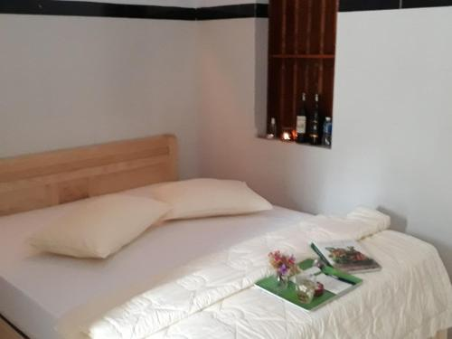 A bed or beds in a room at Shalom Accommodation Lagi