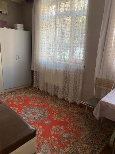 Uma área de estar em CINEMA-FRIENDSHIP 3 bedrooms
