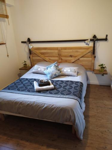 Un ou plusieurs lits dans un hébergement de l'établissement Aux oiseaux de passage