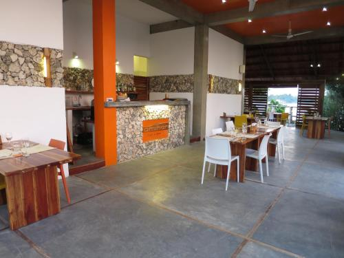 A restaurant or other place to eat at Tepanee Beach Resort