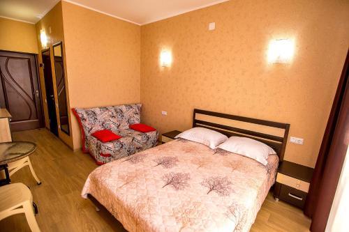 Кровать или кровати в номере Regaliya