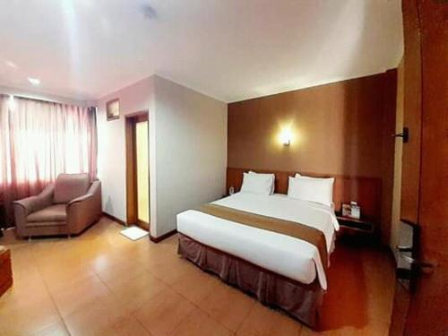 A bed or beds in a room at Citra Inn Hotel