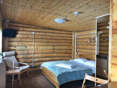 Кровать или кровати в номере ОК - Река