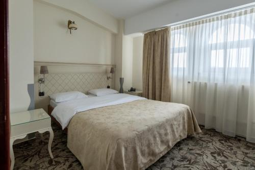 A bed or beds in a room at Casa Siqua