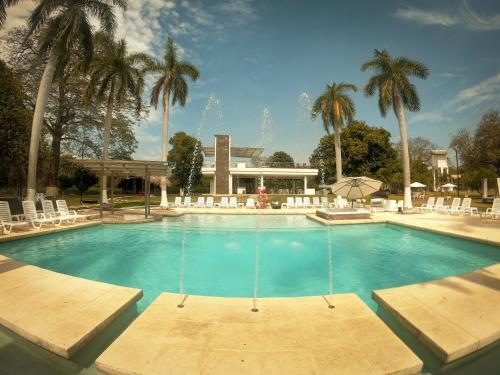 The swimming pool at or near Hotel Arena Santa Fe de Antioquia