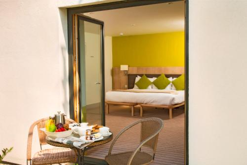 A bed or beds in a room at Lifehouse Spa And Hotel