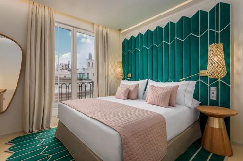 Ein Bett oder Betten in einem Zimmer der Unterkunft Room Mate Macarena – Gran Vía