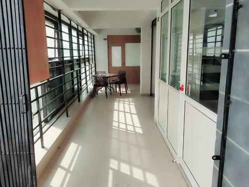 A balcony or terrace at Aaramgruh Hotel Dormitory