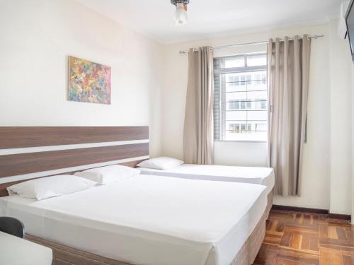 Cama ou camas em um quarto em Libero Hotel