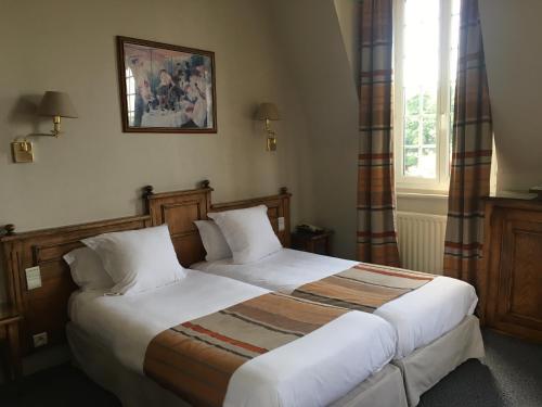 Un ou plusieurs lits dans un hébergement de l'établissement Chateau d'As