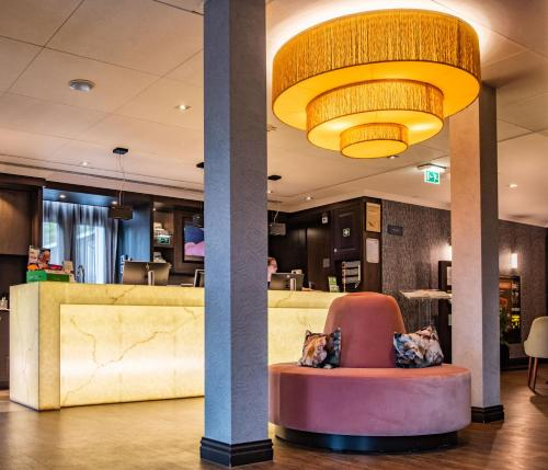 De lobby of receptie bij Hotel & Spa Savarin