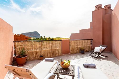 A balcony or terrace at Home2Book La Tejita Beach and Pool