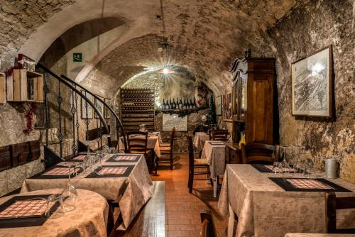 A restaurant or other place to eat at Locanda Cantina Di Bacco