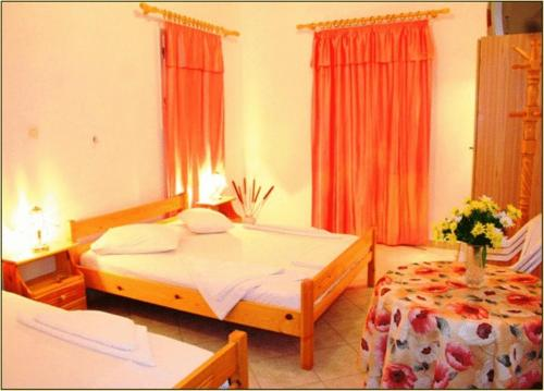 A bed or beds in a room at Pension St.George Rooms & Studios