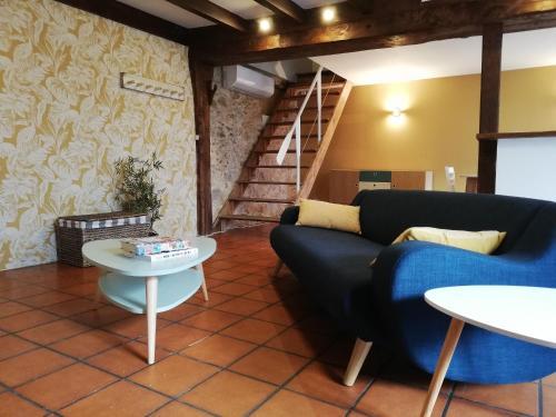 Coin salon dans l'établissement Maison Normande proche de la mer et des commodités