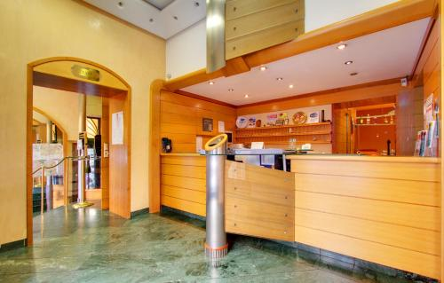 The lobby or reception area at Hotel Corot