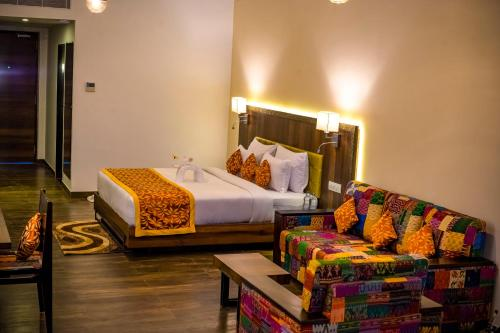 A bed or beds in a room at Via Lakhela Resort & Spa