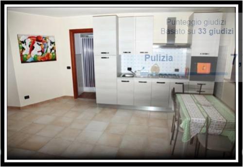 A kitchen or kitchenette at Villa Suber