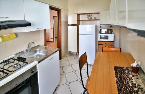 A kitchen or kitchenette at Residenza Parco Ducale