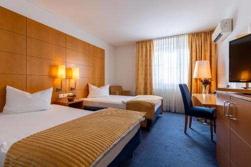Ein Bett oder Betten in einem Zimmer der Unterkunft Trip Inn Kongresshotel Frankfurt-Rodgau