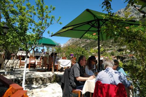 A restaurant or other place to eat at ROOMS EMILIANO Castle of Kruja