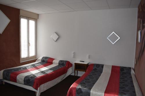 Un ou plusieurs lits dans un hébergement de l'établissement Le Rider