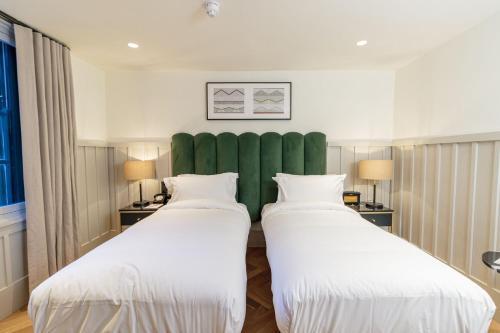 Un ou plusieurs lits dans un hébergement de l'établissement The Clarence
